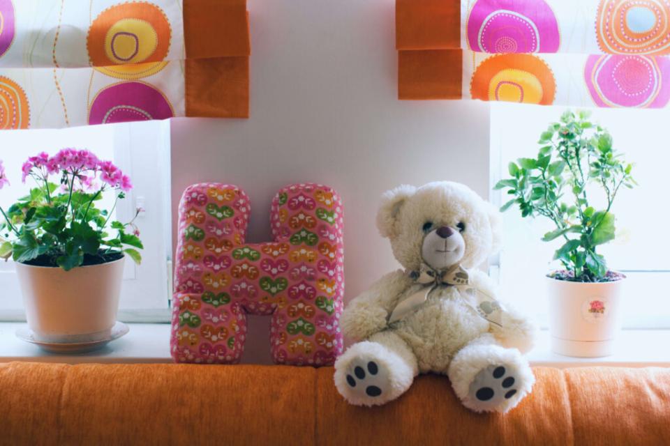 stuffed teddy and flowers