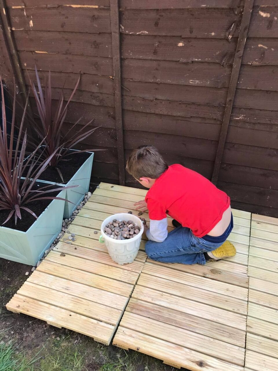 Jake laying the stones around the decking