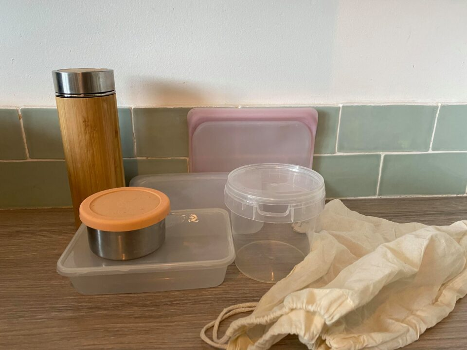 a selection of reusable pots and takeaway containers plus bag for refilling