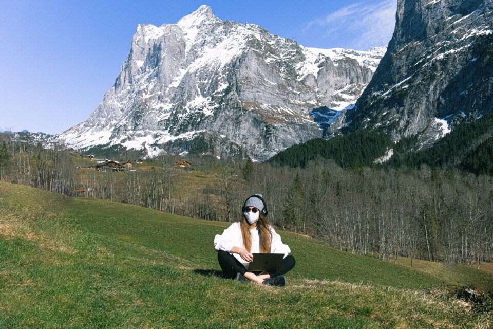 lady in the mountains wearing a mask