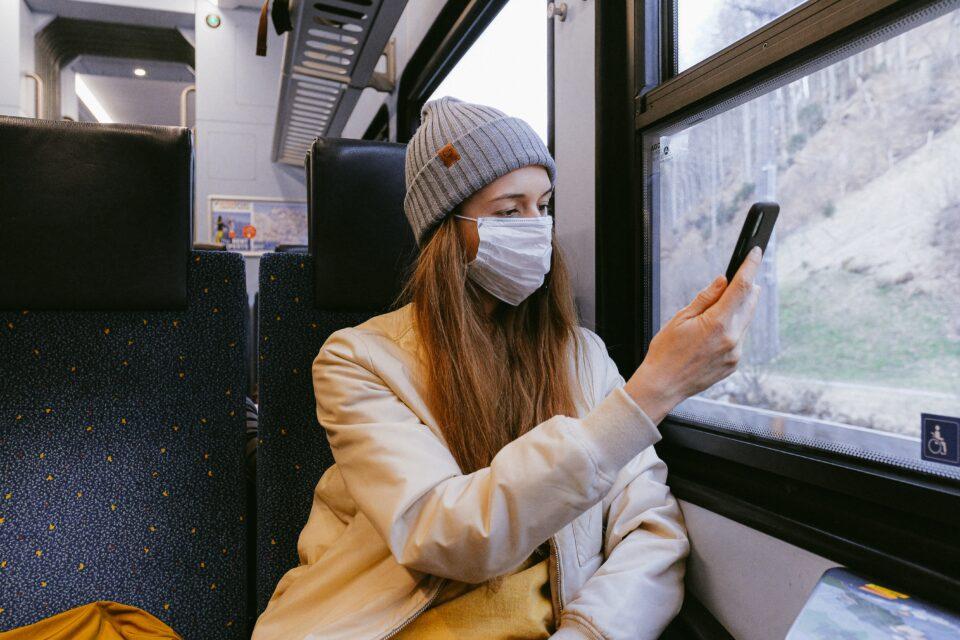 lady on a train wearing a mask