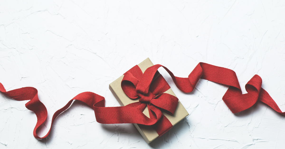 a gift with red ribbon