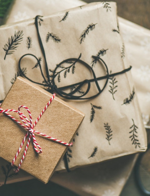 gifts wrapped in brown paper and string