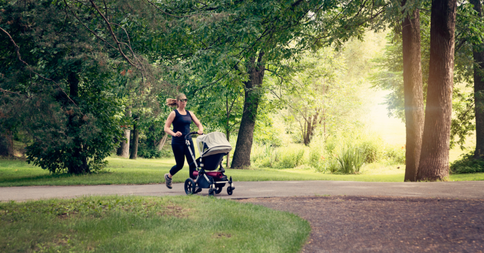 a mum jogging with a stroller
