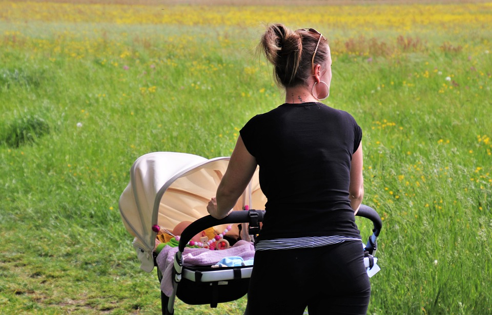 mum and baby in a stroller in a park